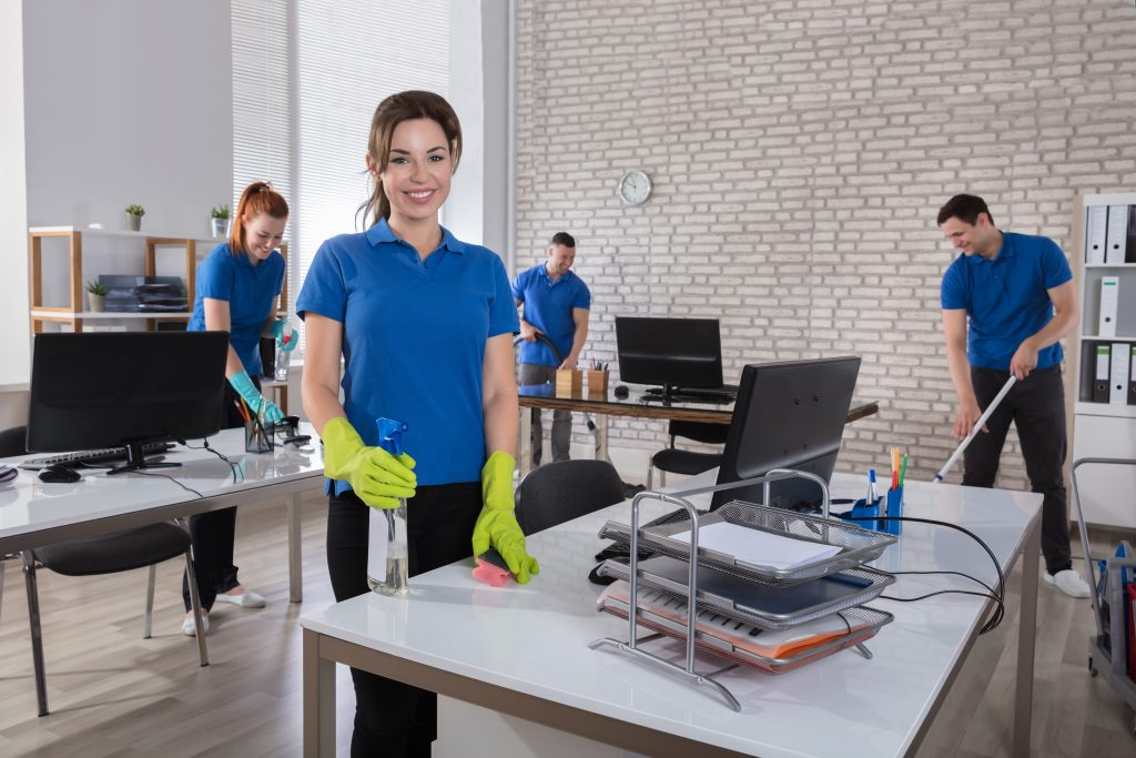 Group of cleaners cleaning an office space