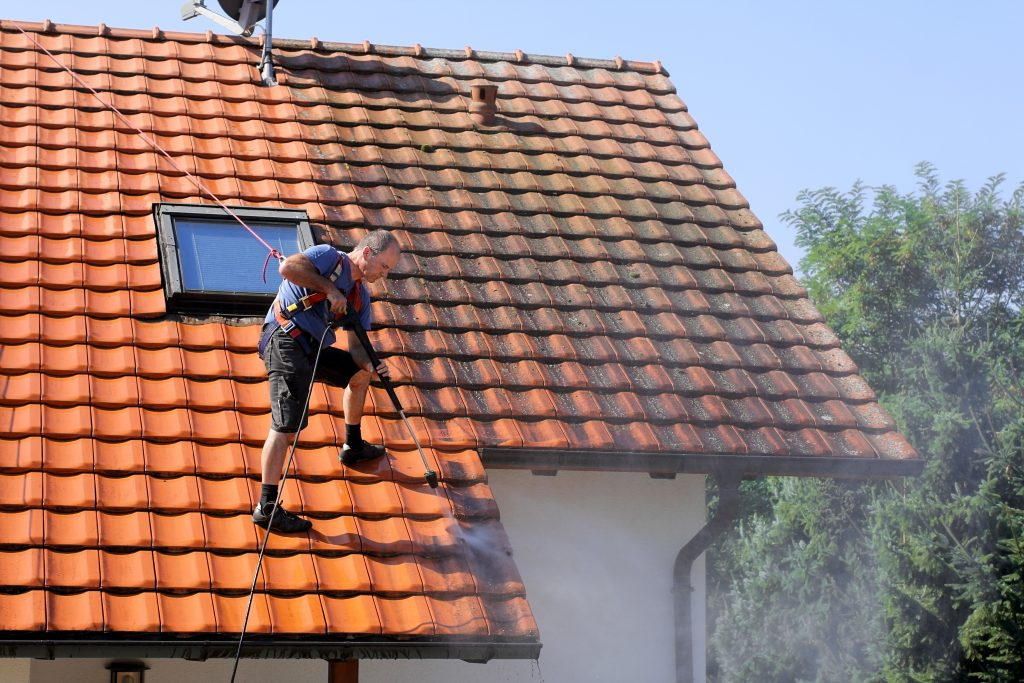 a garden hose and clean your gutters fast
