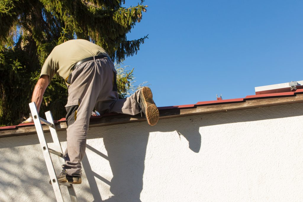 Rubber-soled shoes have the right grip for cleaning gutters